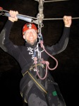 Alex zip lining into a cave. They call ziplines flying foxes in NZ.